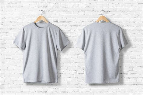 Blank Grey Tshirts Mockup Hanging On White Wall Front And